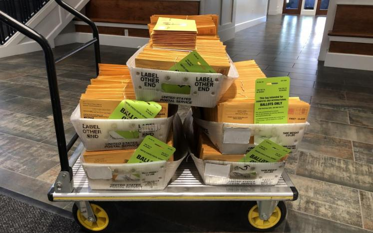 tray of vote by mail ballots